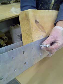 Placing a Coach Screw into a BM6 Joist End Repair Plates