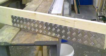 Aluminium Splice Plate joining two pieces of joist